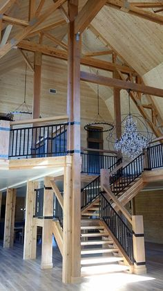 Grand entry of a barn turned elegant farmhouse - check out that chandelier!                                                                                                                                                                                 More