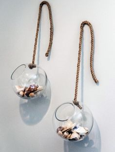 Seashell Display Wall Decor Idea: Glass globes filled with seashells hanging on wall: http://www.completely-coastal.com/2016/05/coastal-home-makeover-Chip-Joanna-Gaines.html