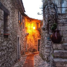 A quiet alleyway in Eze, France, a small town with beautiful views. Photo courtesy of twins_that_travel on Instagram.