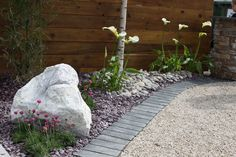 Black riven limestone setts pictured here at the Balmoral Show with Irish barley quartzite aggregate' plum slate' Scottish beach cobbles and meadowgrass marble rockery. For further images and info please visit our Private Places-Show Gardens Gallery.