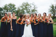 bridesmaids in navy gowns Photography: Firm Anchor - www.firmanchor.com  Read More: http://www.stylemepretty.com/southeast-weddings/2014/04/23/colorful-vineyard-wedding-in-the-rain/