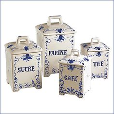 Andrea By Sadek French Script Canister Set: Andrea by Sadek French Script Canister Set. A set of four canisters: Farine, Sucre, Cafe, and The handpainted ceramic in blue classic fleur-de-lis motif, sure to dress up any countertop. Canisters approx 8
