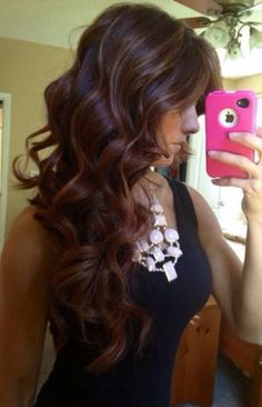 Brown hair with light and copper highlights.