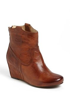 Free shipping and returns on Frye 'Carson' Wedge' Bootie at Nordstrom.com. A hidden-wedge heel elevates a hand-antiqued leather bootie with Western-inspired elements and a tabbed topline. Bench-crafted by hand, Frye's 150-year-old heritage of quality leatherwork is evident in every detail.