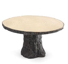 This sturdy rustic wedding cake stand is mimics the the shape and style of a real wood cake stand without the hassle of falling off bark and