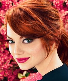 Emma Stone I'm a fan! And her hair no matter what color suits her well!!!! Dmb