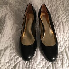 ❄️SNOW SALE!!❄️Coach patent pumps Coach authentic black patent leather pumps. Pre loved; wear on heels and inside shoe, but barely noticeable. Flattering almond toe. Coach Shoes Heels