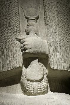 "Merit holding a menat, a musical instrument (rattle). ""In Egyptian mythology, Meret (also spelled Mert) was a goddess who was strongly associated with rejoicing, such as singing and dancing."" (Text from: en.wikpedia.org)"