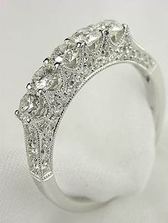 Antique Style 5 Stone Diamond Wedding Ring, RG-2420d, The 18k white gold band of this 5 stone ring is set with fifty-four round full cut diamonds along its archway creating a fabulous shimmering design. The total diamond weight is 1.0 carats. This is a new wedding ring in the antique style. Ring size 6.0