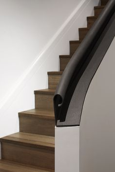 Curved handrail detail on the stairs at Canterbury Road Residence in Middle Park