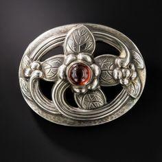 Georg Jensen Garnet Sterling Silver Brooch $695.00. Via langantiques.com