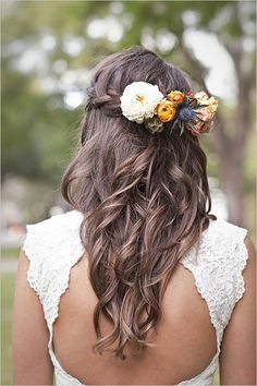 Pretty braided flower accessory wedding hairstyle with loose curls for medium to long hair; Featured Photographer: Kari Crowe Photography