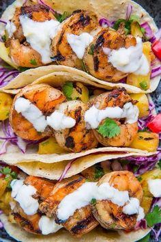 Shrimp Tacos with Pineapple Salsa, Slaw and Pina Colada Crema recipe ~ Dang this sounds good!!