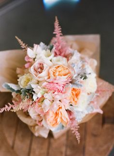 loving these pinks and coral and sea foam green wedding colors... and this floral arrangement is awesome!
