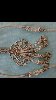 What a wonderful way of using soutache, love the celtic knots, will try figuring out how its done