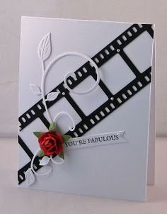 black and white card with a pop of red ... like the crispness of this color combo ... silhoutte cut film strip ... lovely ...