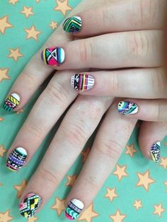 Tribal nail art with pops of color is perfect for a spring break manicure.   #nail #art