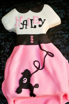 Poodle skirt cake. Though I would change the mixed color writing as you only notice the black. But the cake concept is really cute!