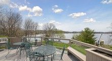 3051 202nd Court E has a large deck in the backyard with a beautiful view of Prior Lake