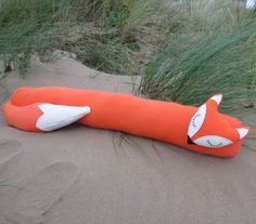 Long fox.  A snoozy fox draught excluder, made from a vibrant orange wool. £38.00