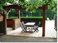 a grape arbor and a place to relax