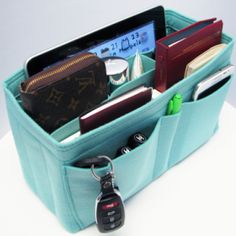 Organize your bag with a felt bag organizer from Samorga. I seriously need one of these, such a good idea!!