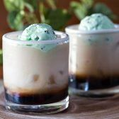 Floating Yoda Cocktail! Enjoy a Star Wars movie night by honoring Jedi Master Yoda with one of the best white Russian variations: Kahlua and milk that's topped with mint ice cream!   HomemadeHooplah.com