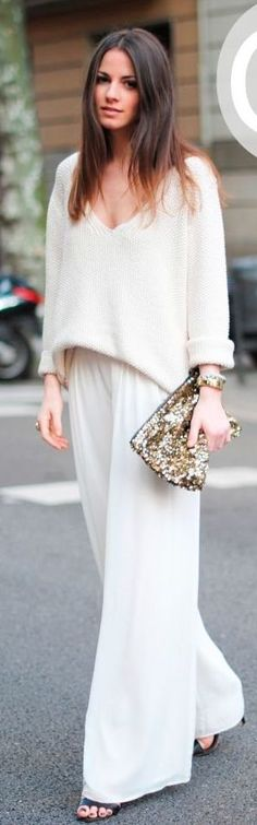 It's all about the drape and that great clutch... I want to try my own version of this look with a light, white summer sweater and palazzo pants