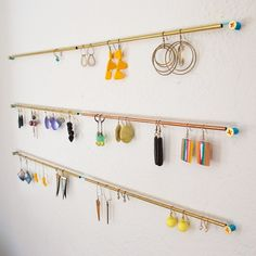 Earring rack made with brass tubes, copper wiring, and screws. #apartmenttherapy