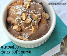 Healthy 'soft serve' with three main ingredients...frozen banana, cocoa and almond milk. So healthy too! From shrinkingkitchen.com #healthy #dessert #icecream #recipe