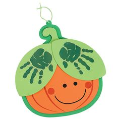 Handprint Pumpkin Craft Kit - OrientalTrading.com  I'm thinking of a card with little hands or a canvas paint project....