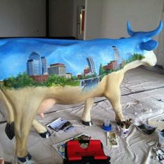 Preparing for the 2012 CowParade in North Carolina...I saw the Durham Traveler in Durham with Danielle.
