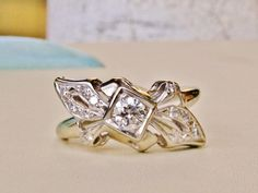Hey, I found this really awesome Etsy listing at https://www.etsy.com/listing/184975568/vintage-diamond-engagement-ring-unique