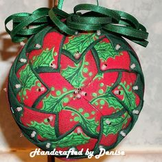 Holly 3 ~  Quilt looking fabric ornaments made by Handcrafted by Denise.