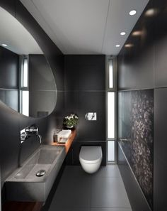 totally dark bathroom & white fixtures. Corian tiles