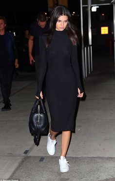 Kendall Jenner dresses up her Adidas with a tight long sleeve black dress