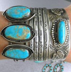 stacked turquoise bracelets.