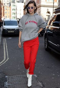 Follow in Bella Hadid's footsteps and make your white boots pop by pairing them with some contrasting bottoms. Take a pair of bold-as trews (in BH's case: the redder, the better), and sprinkle some casj via the medium of a hoodie (note the coordinating slogan) and a pair of 80s cat-eye shades, before adding your bright white boots