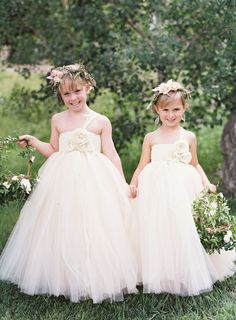 Flower girls in tulle dresses...adorable! | Photography : Brett Heidebrecht Read More on SMP: http://www.stylemepretty.com/colorado-weddings/tabernash/2016/03/08/rustic-colorado-ranch-wedding-infused-with-southern-charm/