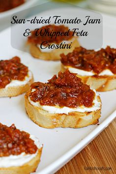 Sun-Dried Tomato Jam and Whipped Feta CrostiniSundried tomato jam and whipped feta crostini....these take crostini applies to a whole new level!