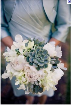Truly a beautiful bouquet.  The softness and the density of the succulent create quite a harmony.  A simple change of succulent color would give this a completely different feeling.  I like this!