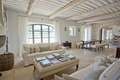 Living room with white washed wooden beamed ceiling