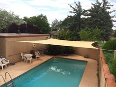 Cream shade sail for a pool covering