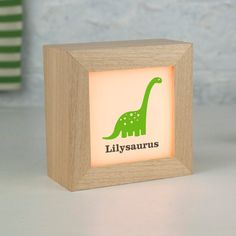 Personalised Dinosaur Lightbox/ solid wood/ child's dinosaur name/ diplodocus dinosaur design/ new baby gift/ looks lovely in the nursery Nursery Shelves, Dinosaur Coloring, Naming Ceremony, Dinosaur Design, Unique Lighting, New Baby Gifts, Baby Names, Night Light, Little Ones