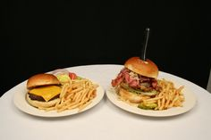 A shot of our regular cheeseburger and one of our Colossal Burgers! Yum!