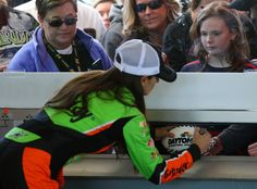 Danica Patrick, driver of the GoDaddy Chevrolet, signs autographs in the garage area during practice for the Annual Daytona 500 at Daytona International Speedway on February 2015 in Daytona Beach, Florida. Sue Patrick, Danica Patrick, Daytona 500, Daytona Beach, Daytona International Speedway, Nascar, Race Cars, Chevrolet, Racing