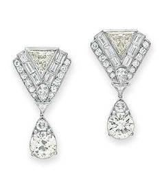 A PAIR OF DIAMOND EAR PENDANTS  Each suspending a drop-shaped pendant set with two old European and circular-cut diamonds, from a variously-shaped diamond shield-shaped surmount, mounted in platinum