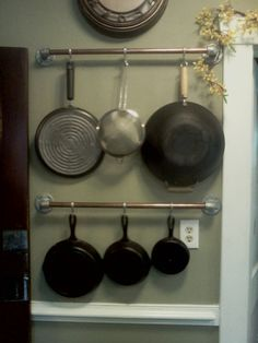 A pot rack made from copper pipe.