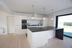 Handleless kitchen. Matt painted in white. Made to measure bespoke units & doors.