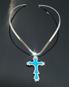 Tulum – Cross Pendant with turquoise inlay on Silver Overlay neckpiece. Inspired in the turquoise colours of the caribbean ocean. Tulum, comes from the name of a Mayan city based on a cliff overlooking some of the most beautiful beaches in the world.  Www.mexicanheart.com